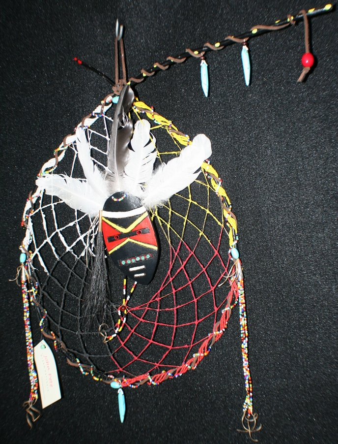 medicine man dreamcatcher by john pete with groud mask and beads, dyed sand, turquoise and feather accents